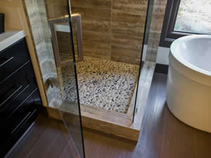 Shower with pebbled flooring